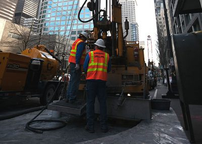 Drilling in the parking lot of a busy city street.