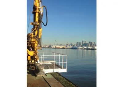 Geotechnical drilling over the edge of a Seattle pier in preparation for Terminal 5 expansion.