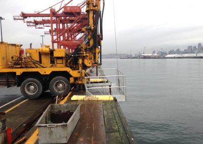 Drill rig setup with platform for over the edge drilling.